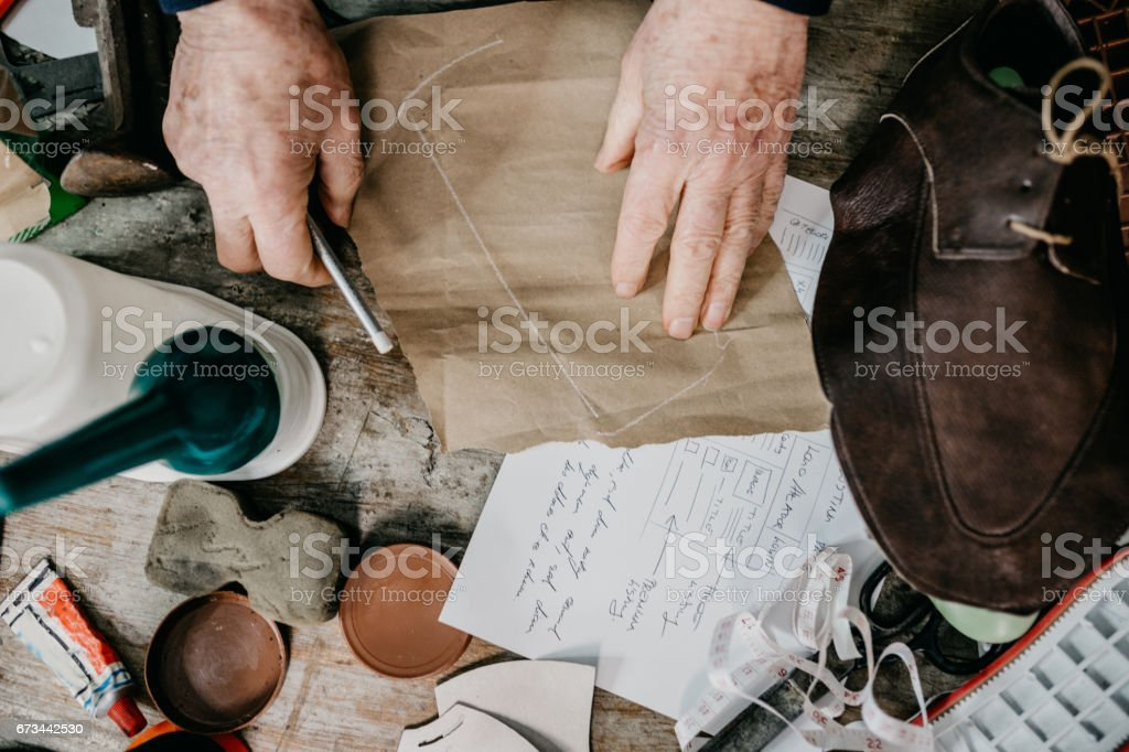 Close up of a cobbler's work table stock photo