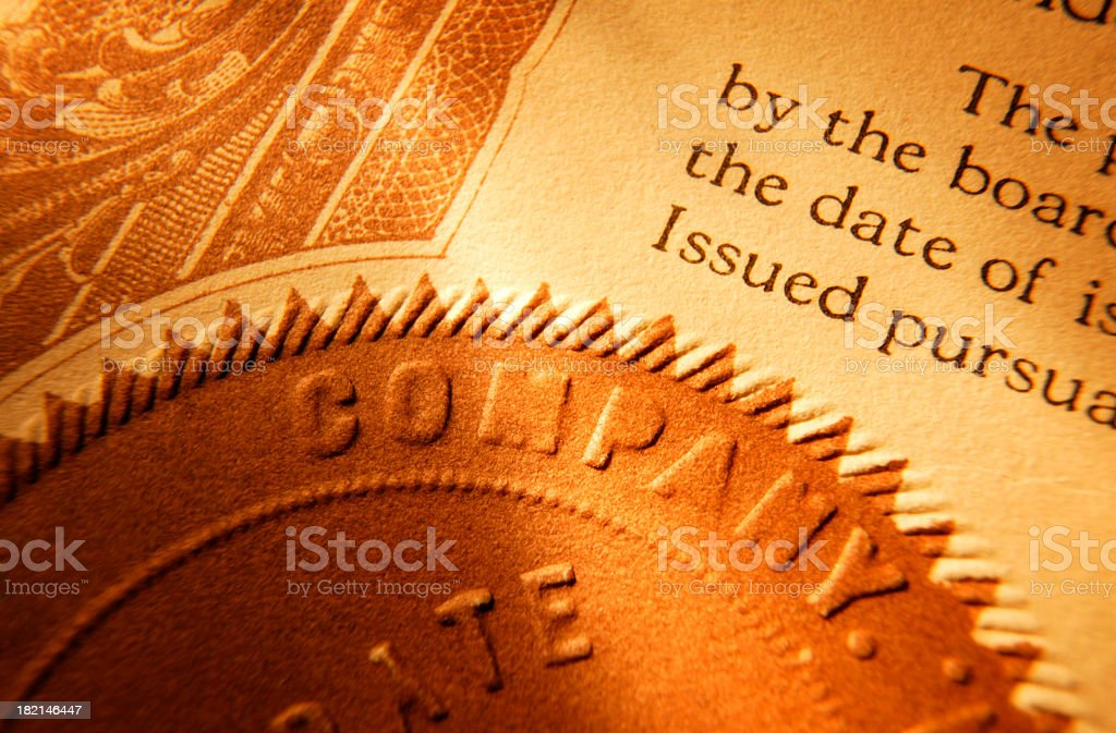 Close up of a company seal on old stock certificate stock photo