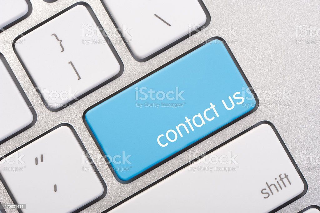 Close up of a contact us key stock photo