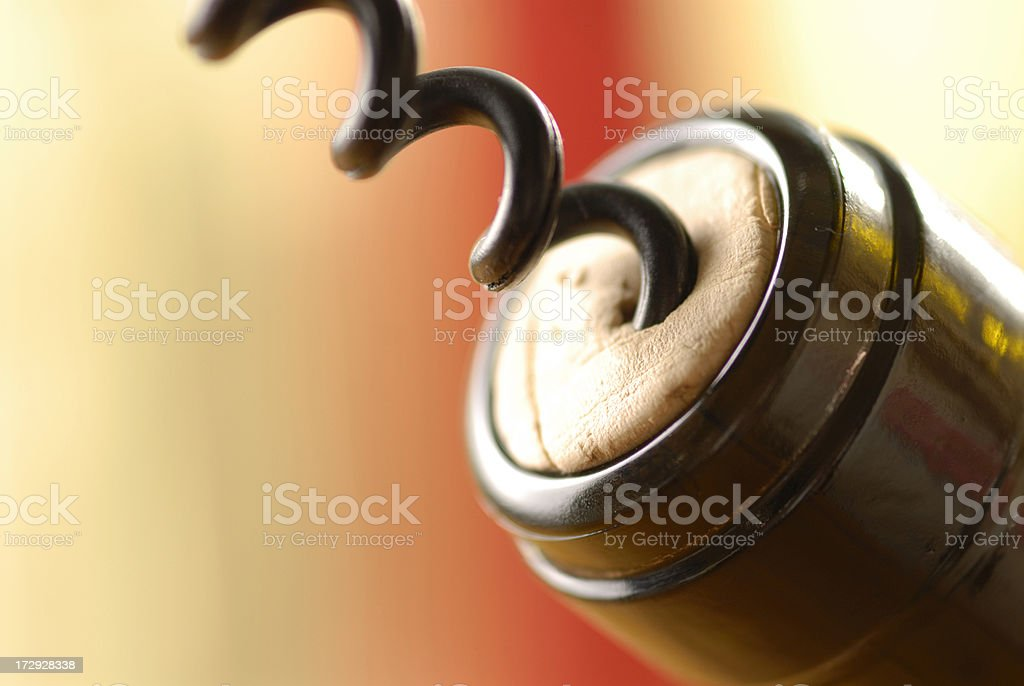 Close up of a Cork Screw in a wine bottle royalty-free stock photo