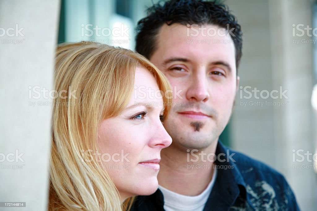 Close up of a couple looking in different directions royalty-free stock photo