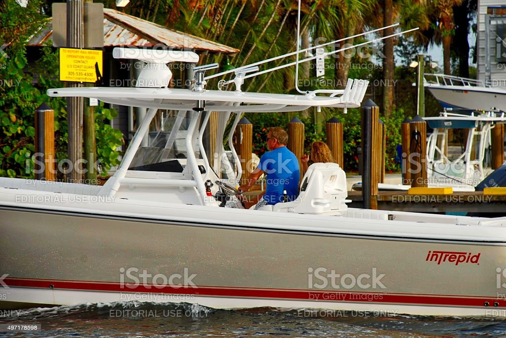 Close up of a couple on a power boat stock photo