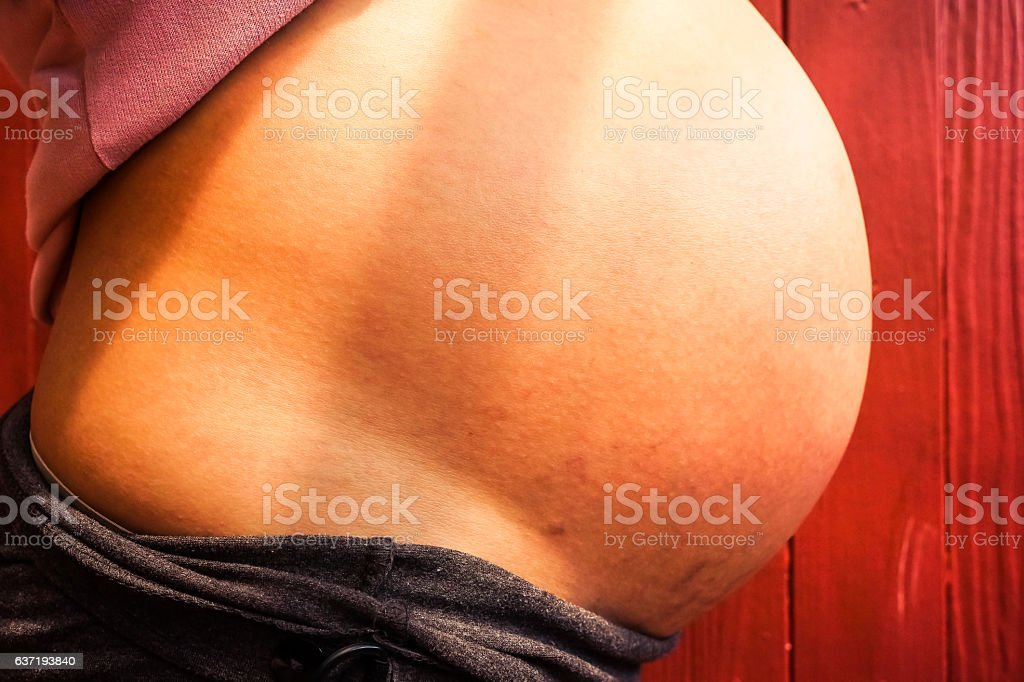 Close up of a cute pregnant belly stock photo