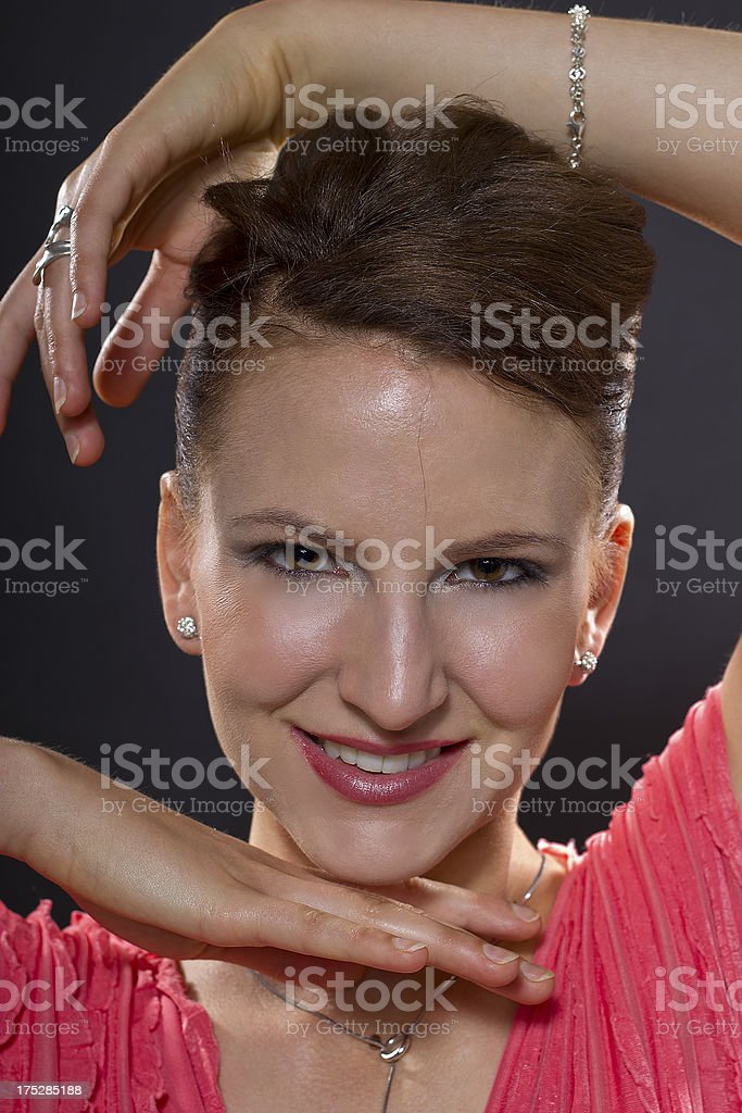 Close up of a Dancer in Pink Framing Her Face royalty-free stock photo