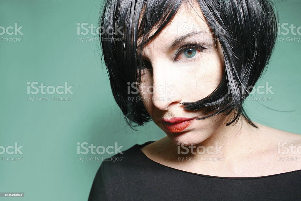 Close up of a dark haired woman royalty-free stock photo