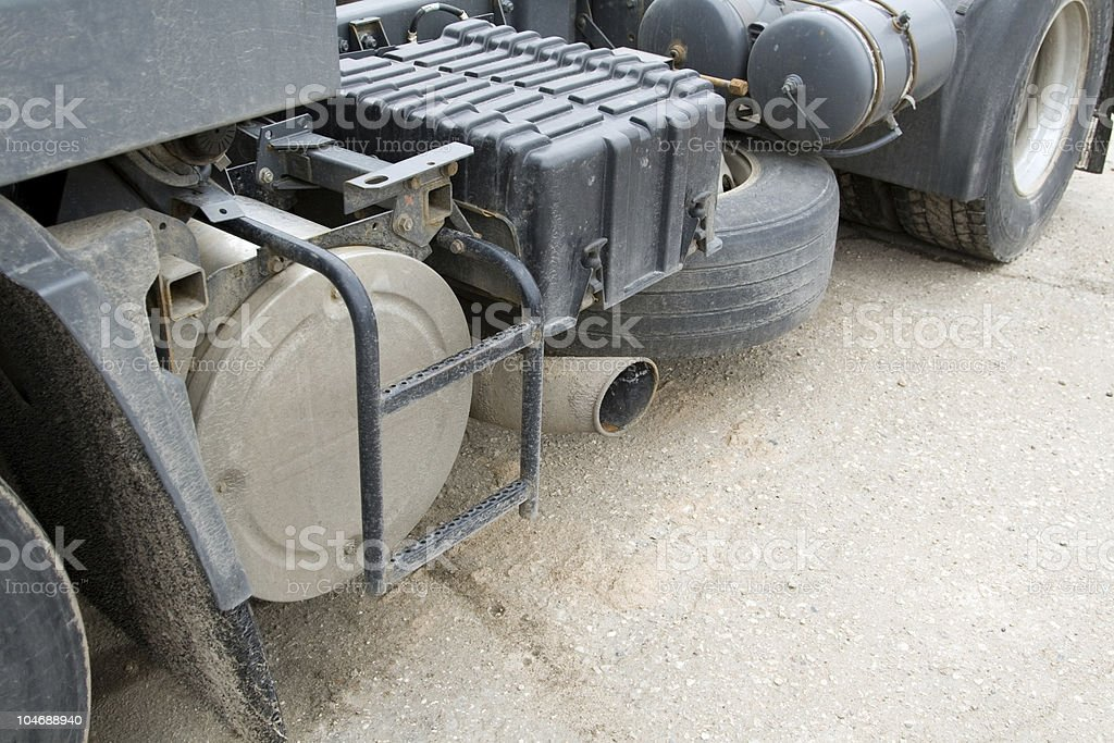 Close - up of a dirty heavy truck`s muffler. royalty-free stock photo