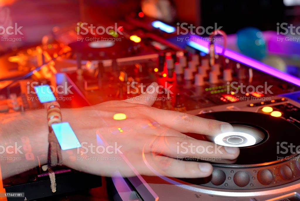 Close up of a DJ's hands, spinning a record on a turntable royalty-free stock photo