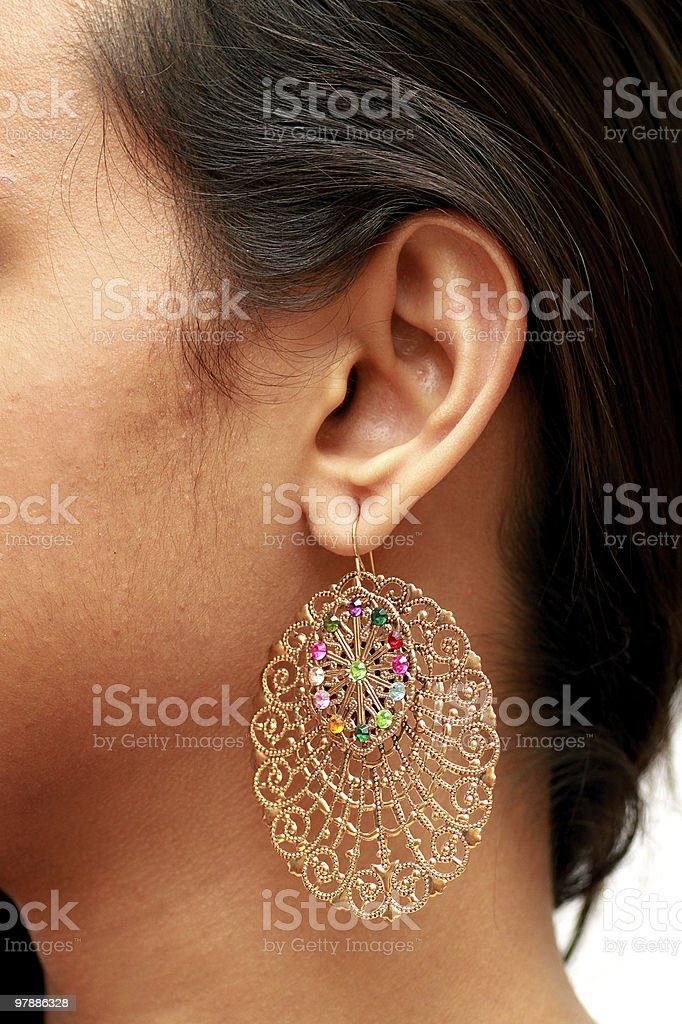 Close up of a ear with earring. stock photo