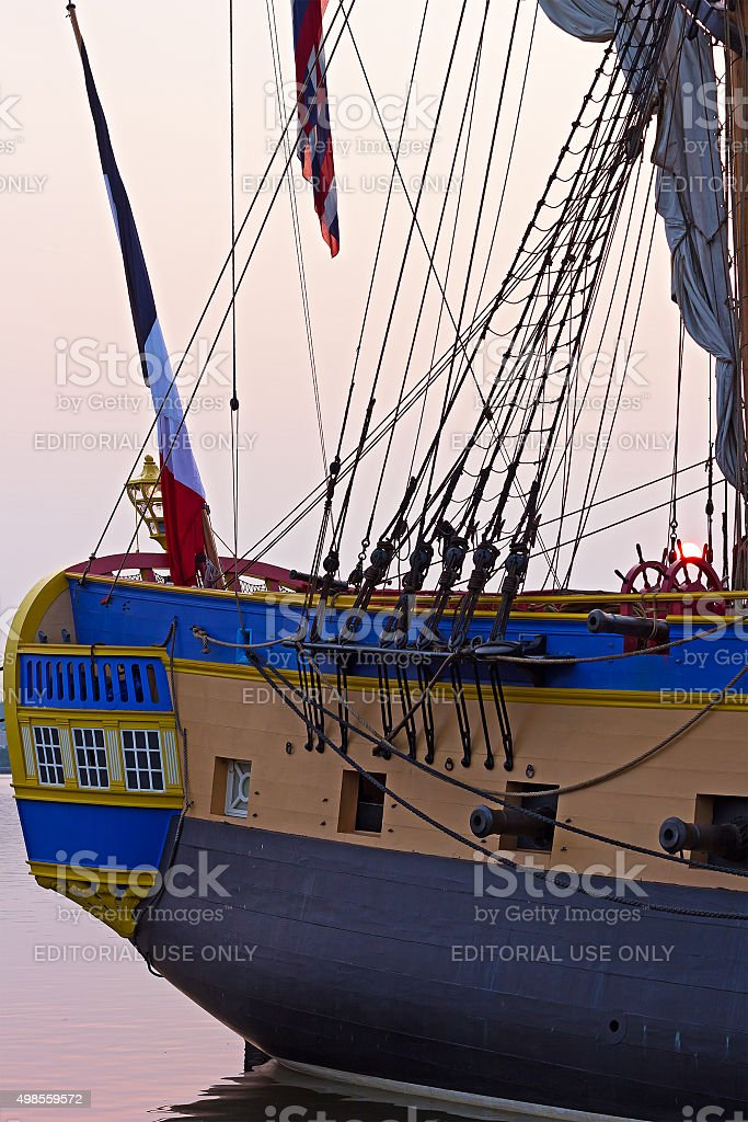 Close up of a famous frigate's stern at sunrise. stock photo