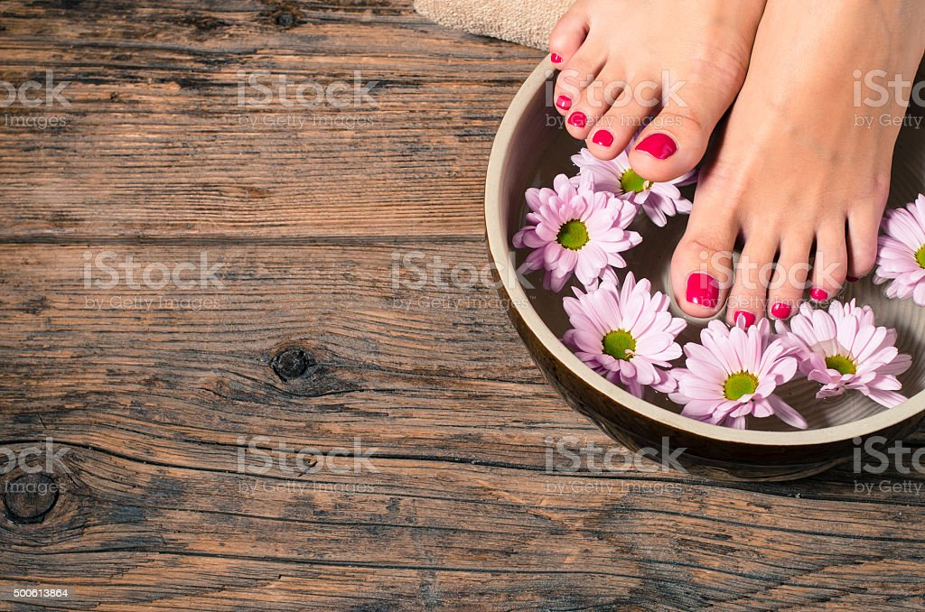 Close up of a female feet in spa salon stock photo
