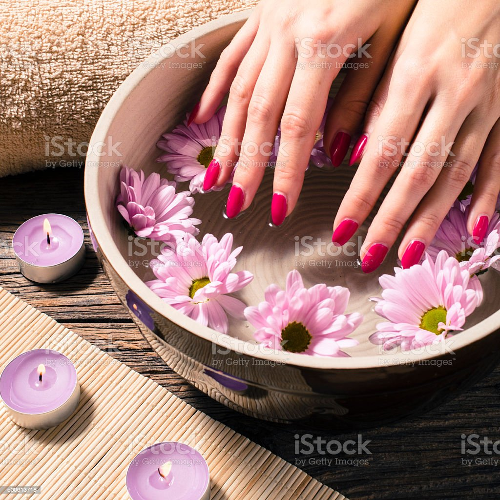 Close up of a female hands in spa salon stock photo