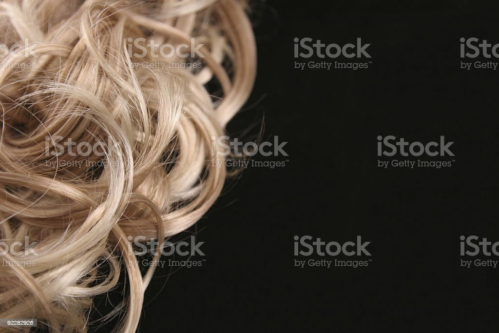 Close up of a female's curly blonde hair royalty-free stock photo