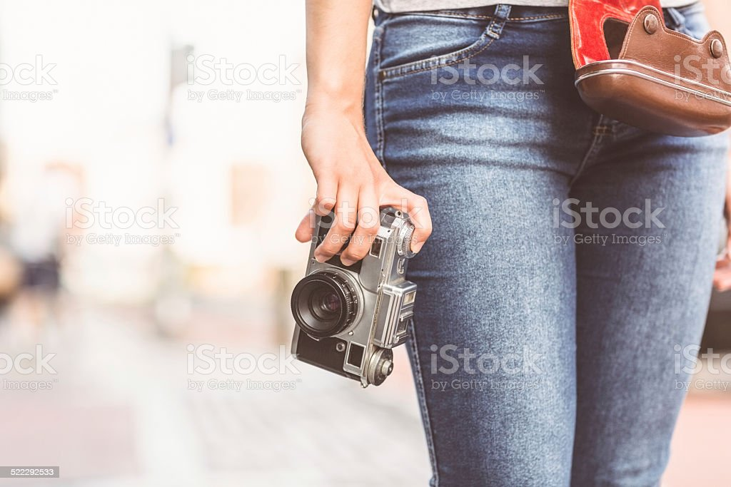 Close up of a girl holding a camera stock photo