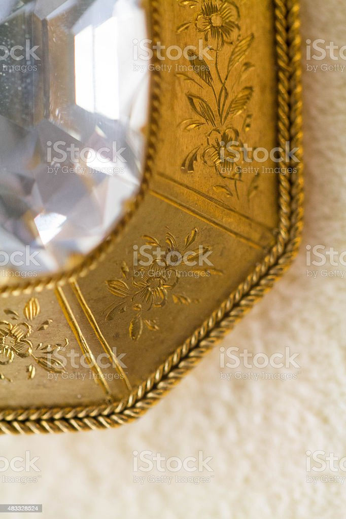 Close up of a Gold brooch with a large diamond stock photo