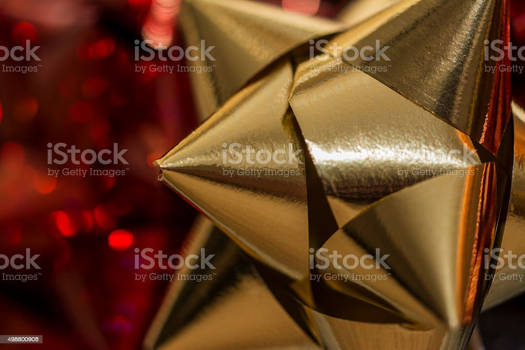 Close up of a gold christmas gift bow stock photo