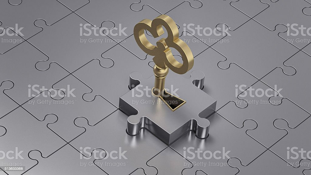 Close up of a golden key and metal puzzle. stock photo