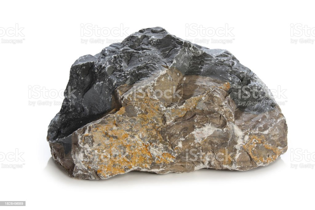 A close up of a gray rock on a white background stock photo