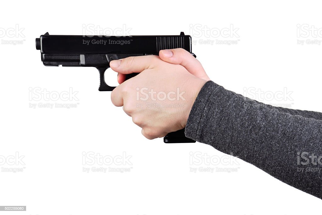 Close up of a gun in a hands stock photo