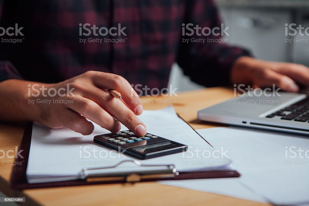 Close up of a hand on a calculator stock photo