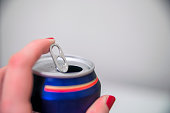 Close up of a hand opening a beverage, (beer) can