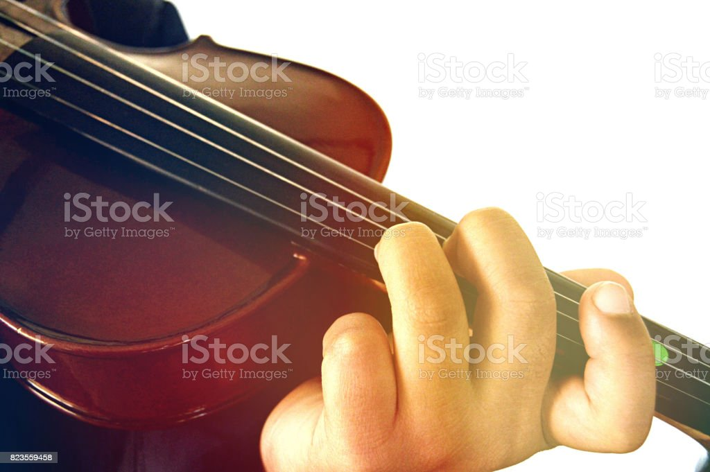 Close up of a hand playing the violin fingerboard on white background. stock photo