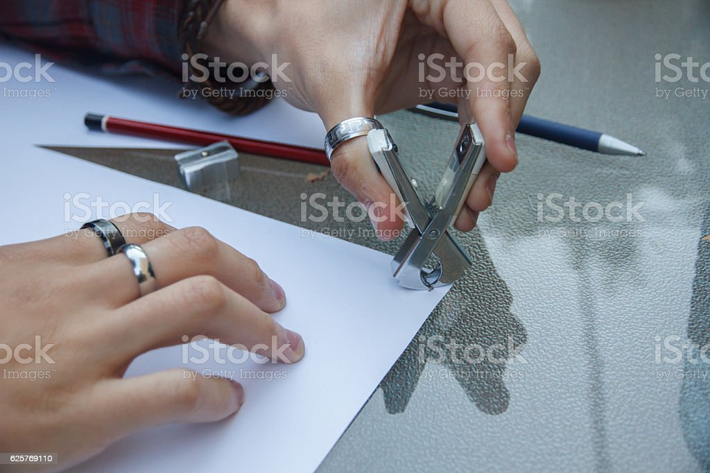 Close up of a hands with a staple remover. stock photo