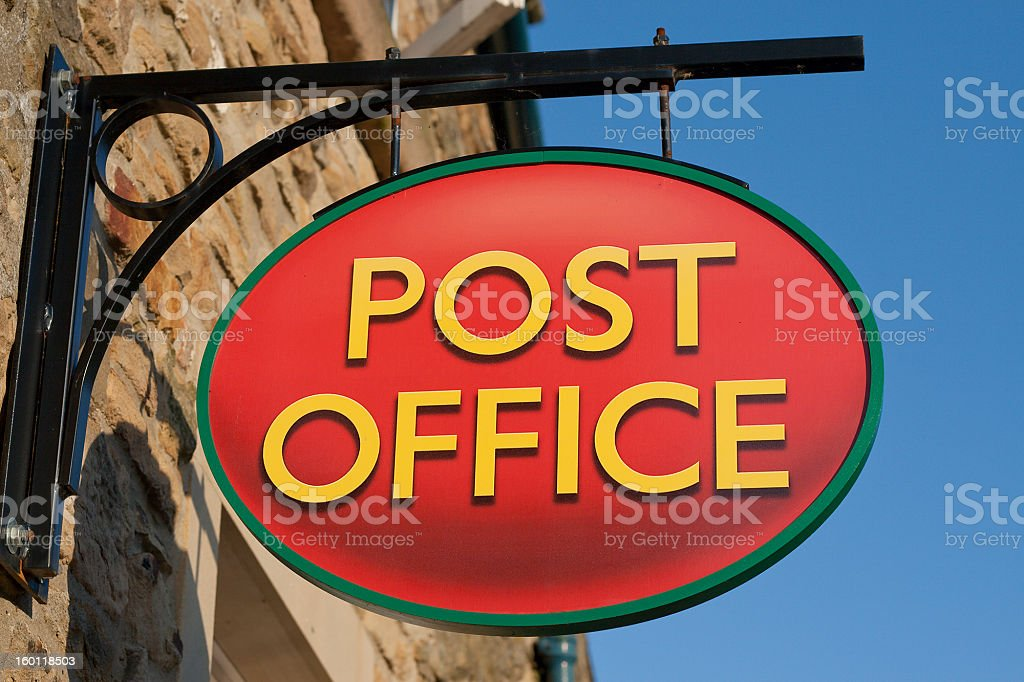 Close up of a hanging red post office sign stock photo