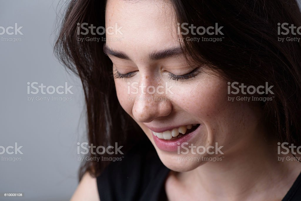 close up of a happy smiling woman with copyspace stock photo