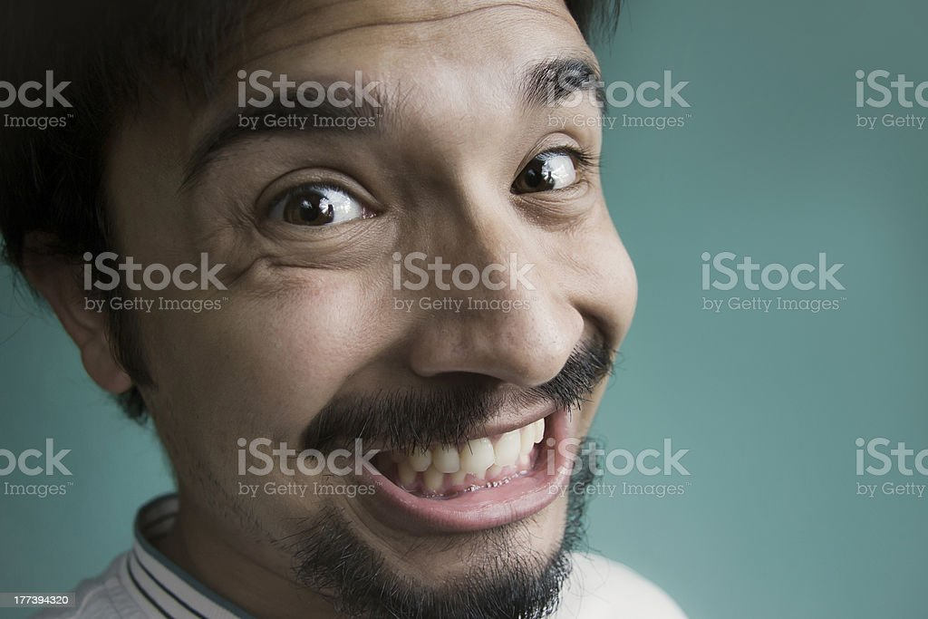 Close up of a happy young man. stock photo