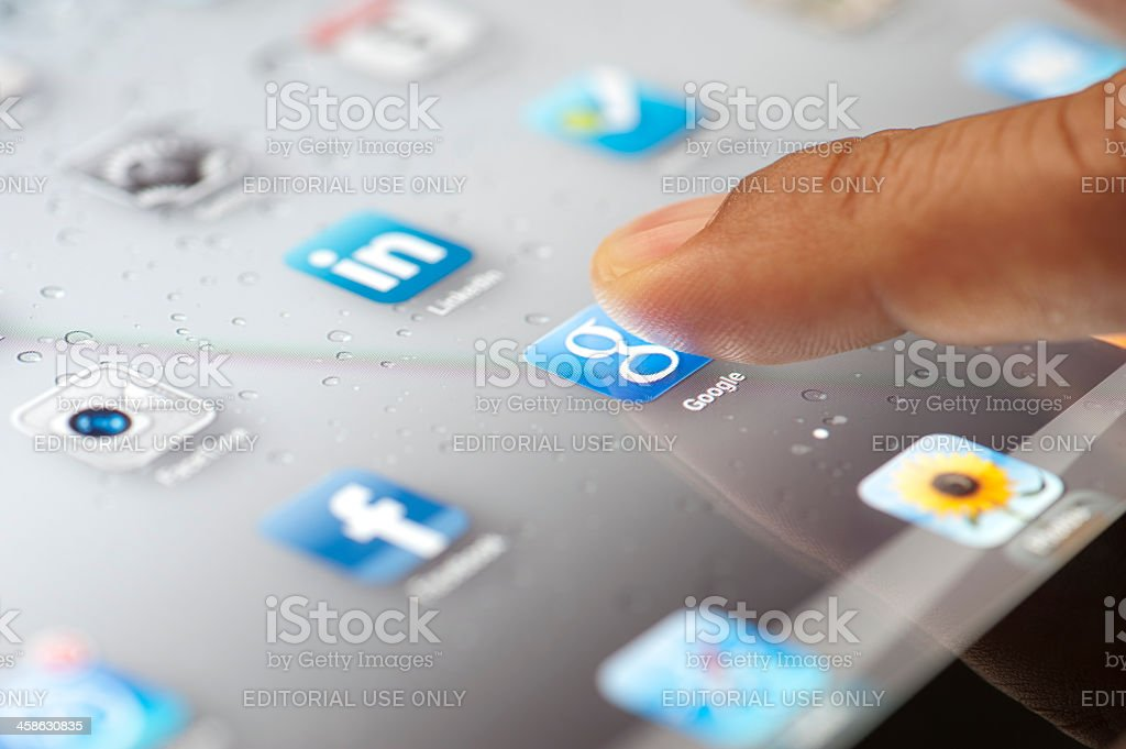 Close up of a ipad screen showing application icons stock photo