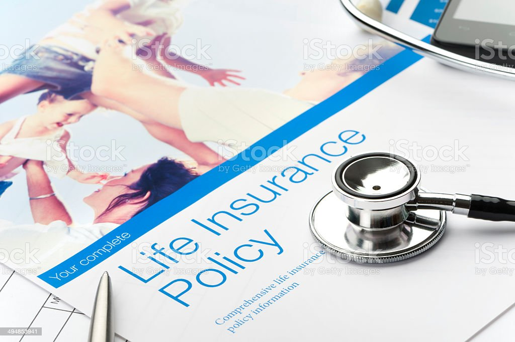Close up of a Life insurance policy with family image stock photo