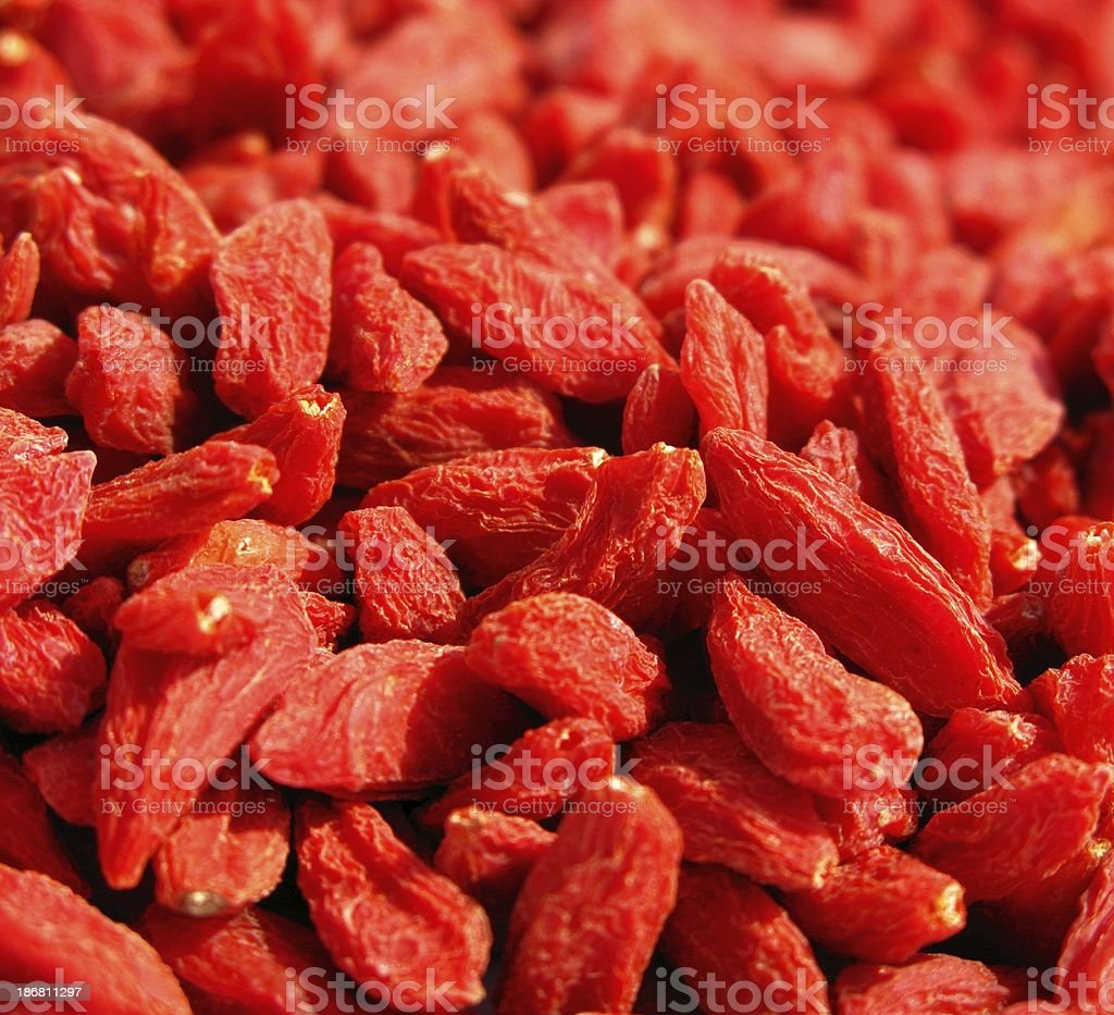 A close up of a lot of goji berries stock photo