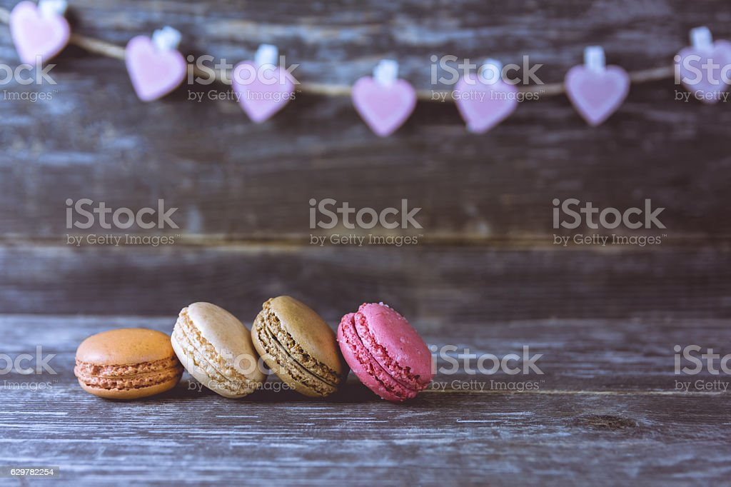 Close UP of a Macaroons, Pink Hearts in the Background stock photo