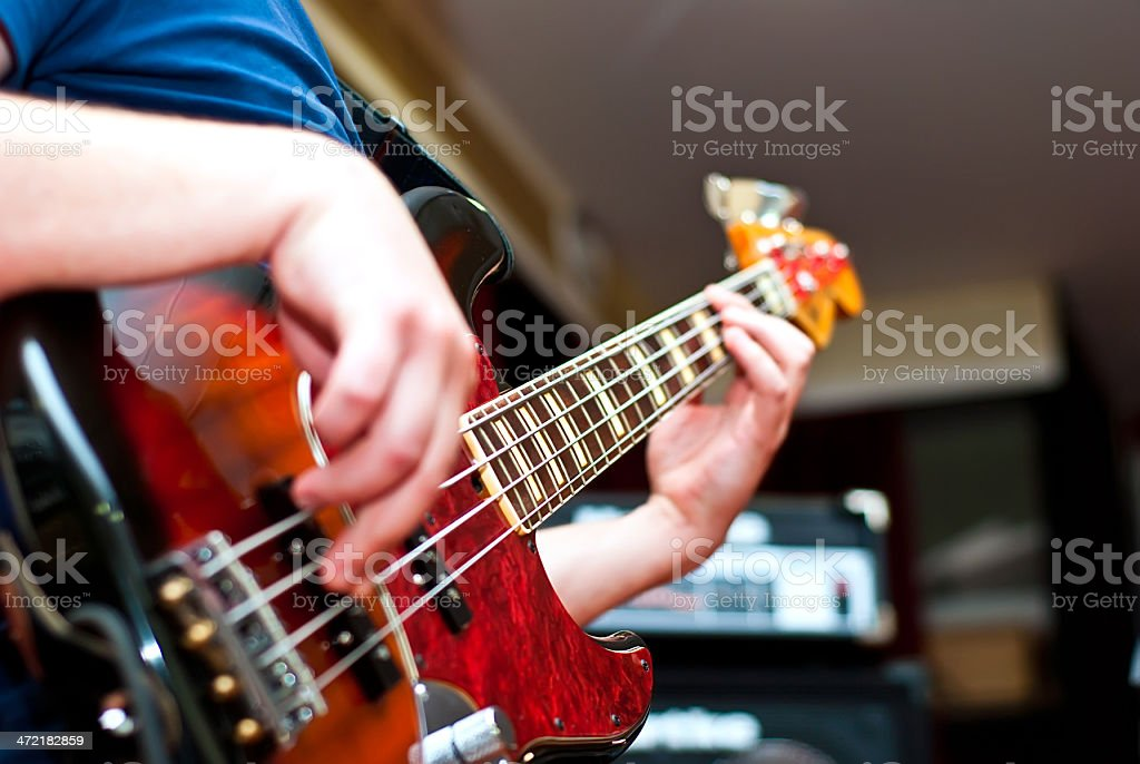 Close up of a male playing the guitar stock photo