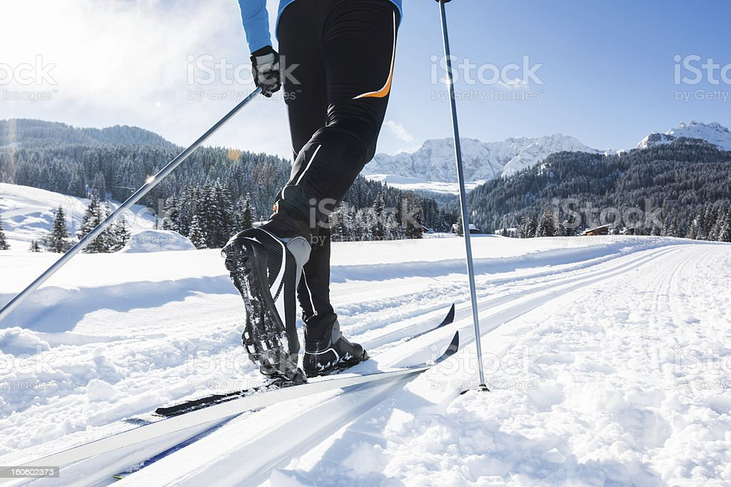 Close up of a male skier cross-country skiing stock photo