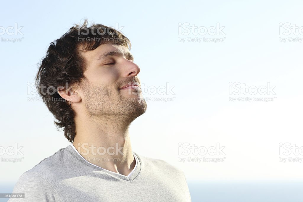Close up of a man doing breath exercises outdoor stock photo