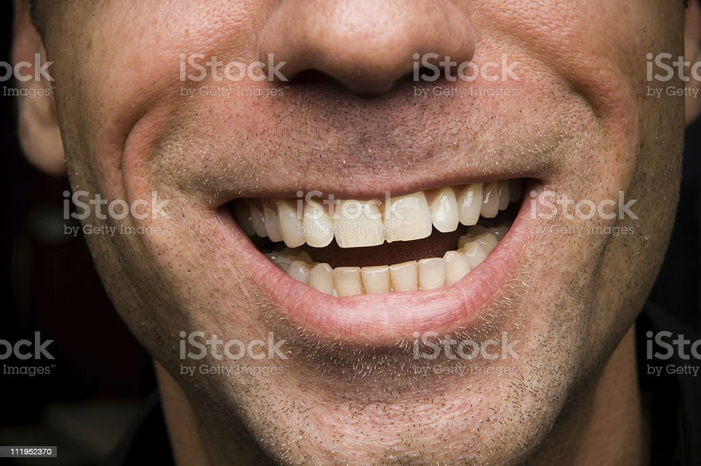 Close Up of a Man Smiling with Stubble royalty-free stock photo