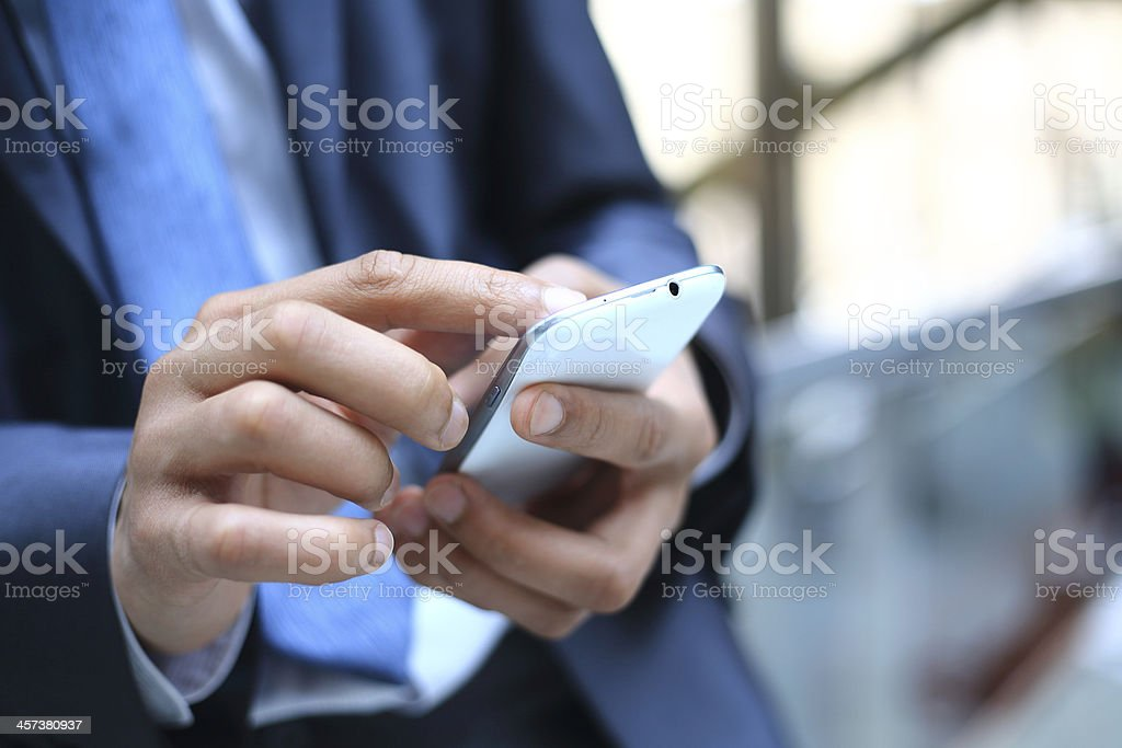 Close up of a man using mobile smart phone stock photo