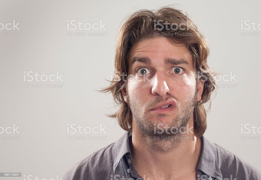 Close up of a man with puzzled look on his face royalty-free stock photo
