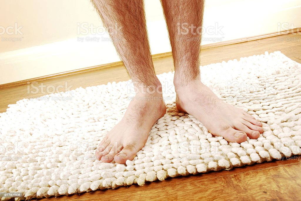Close up of a man's hairy legs after a shower stock photo