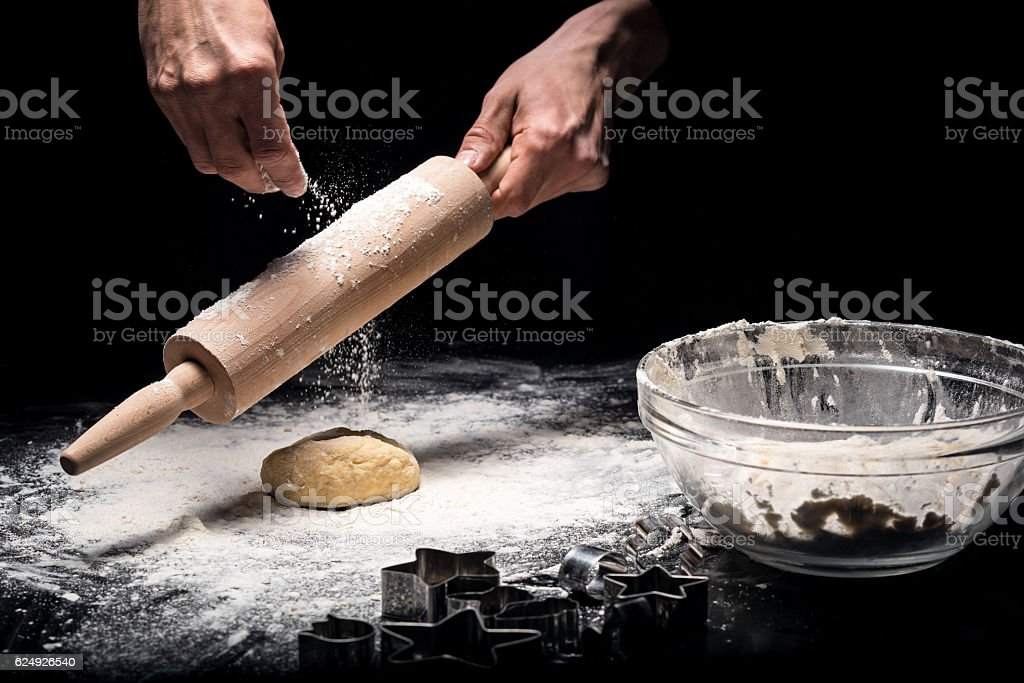 Close up of a mans hands using rolling pin stock photo