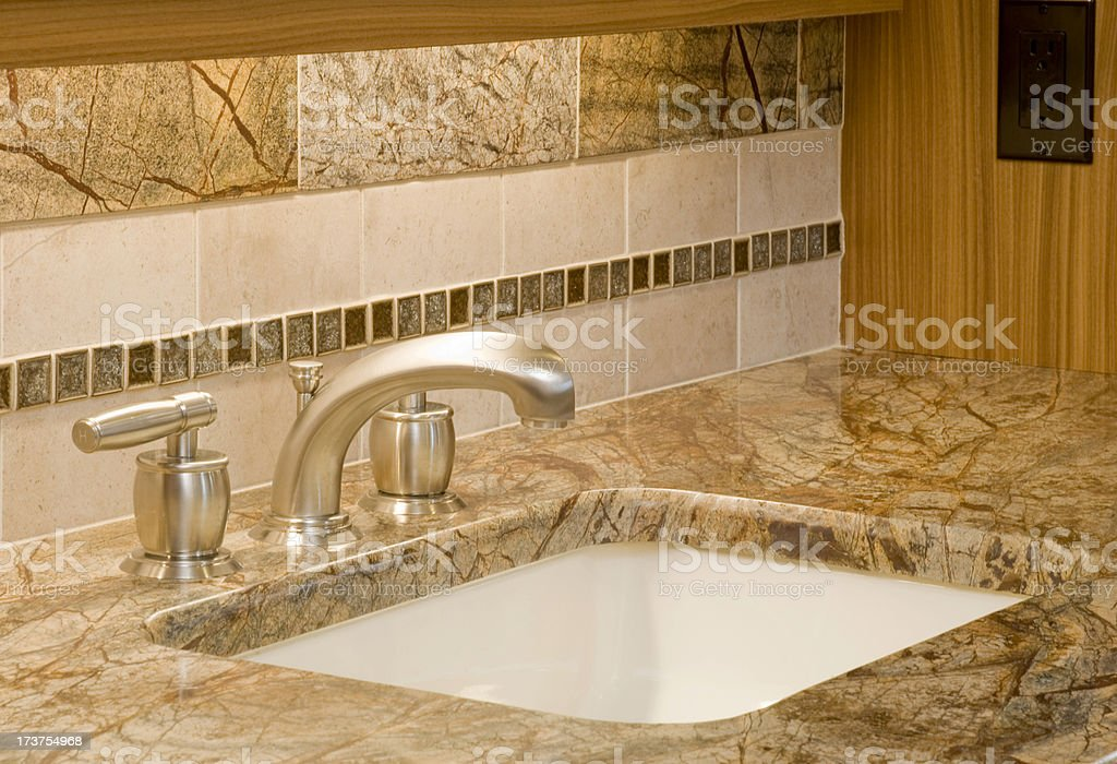 Close up of a marble bathroom sink stock photo