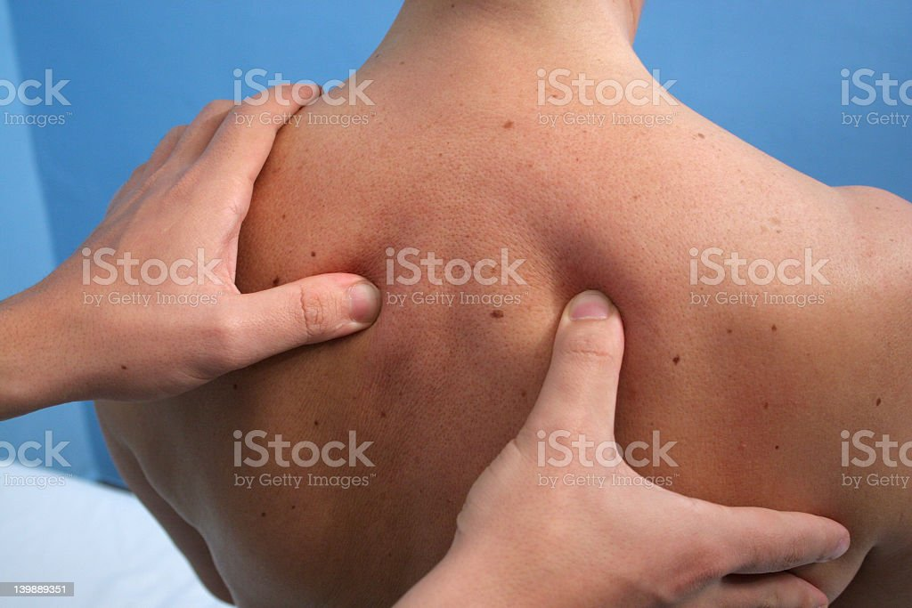 Close up of a massage being given on a human back stock photo