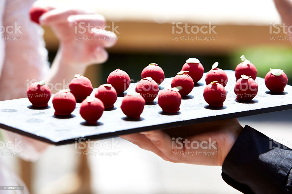 Close up of a maître d'hotel serving food stock photo