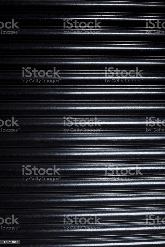 Close Up of a Metal Security Door royalty-free stock photo