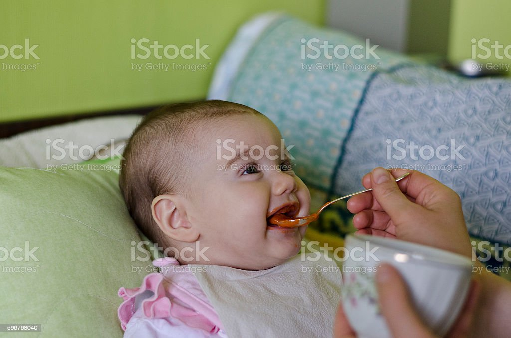 Close up of a mother feeding her baby stock photo