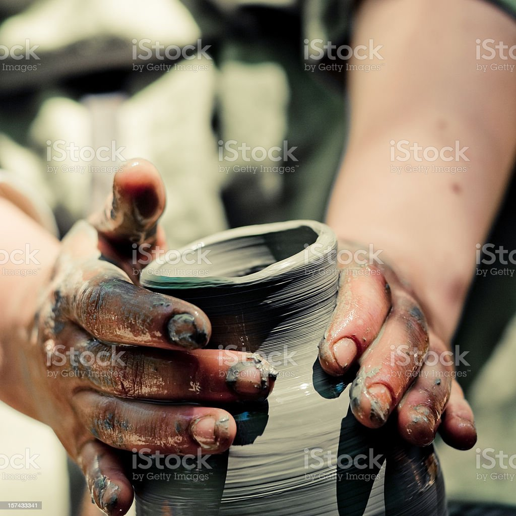 Close up of a pair of hands creating clay pottery stock photo
