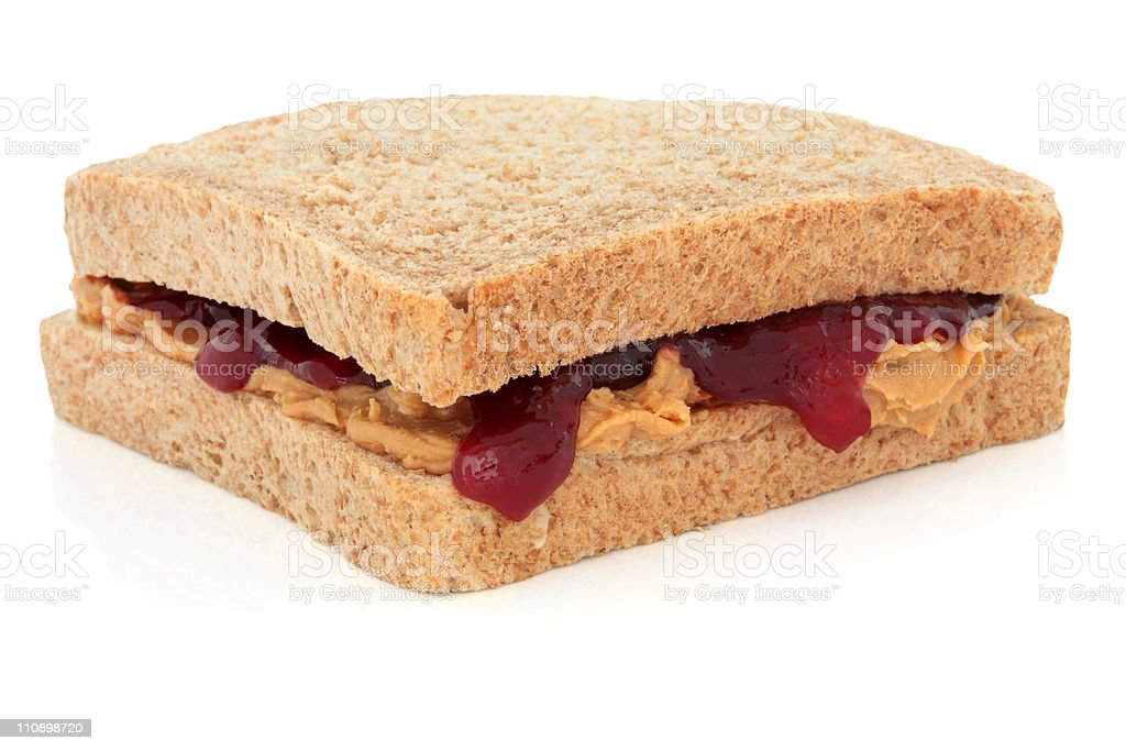 Close up of a peanut butter and strawberry jelly sandwich stock photo