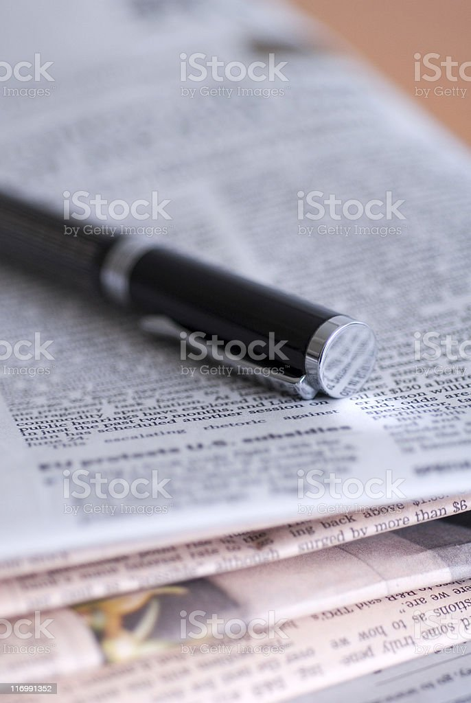 Close up of a pen on financial newspaper royalty-free stock photo