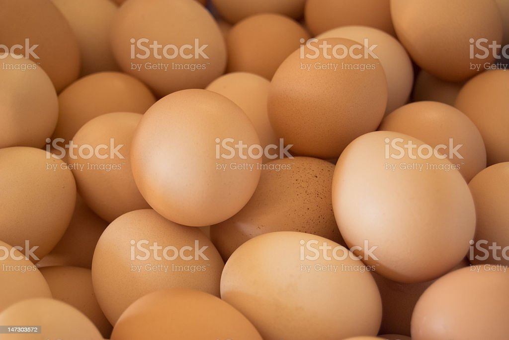 Close up of a pile of brown eggs stock photo